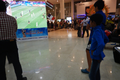 Chennai - Football fan, Nandan in front of a large screen at Chennai Airport