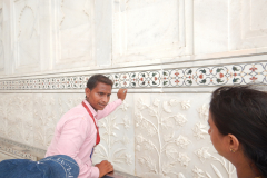 Taj Mahal - Guide is serious about the great works