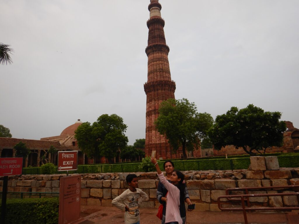 At Qutb Minar; in front of the Minaret