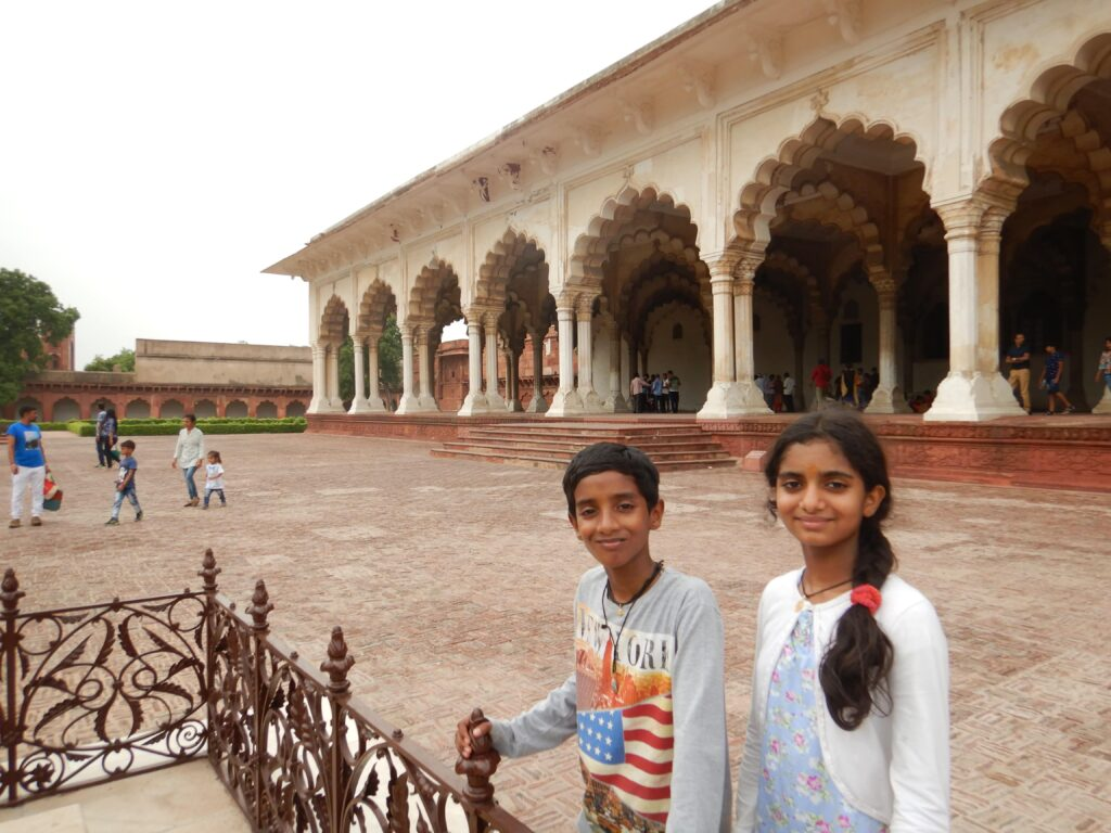 At the Agra fort, standing with brother